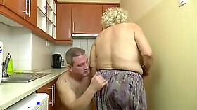 Busty euro fucks her dick in the kitchen