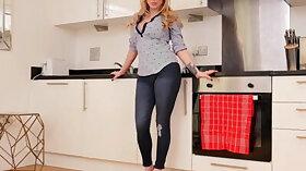 Busty blonde milf fingers herself in the kitchen