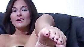 Jerky teacher puts her feet up and demos footjob skills