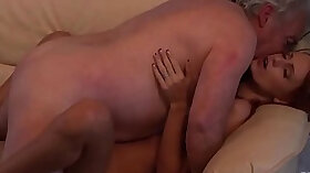 Amazing young redhead pleasing her pussy